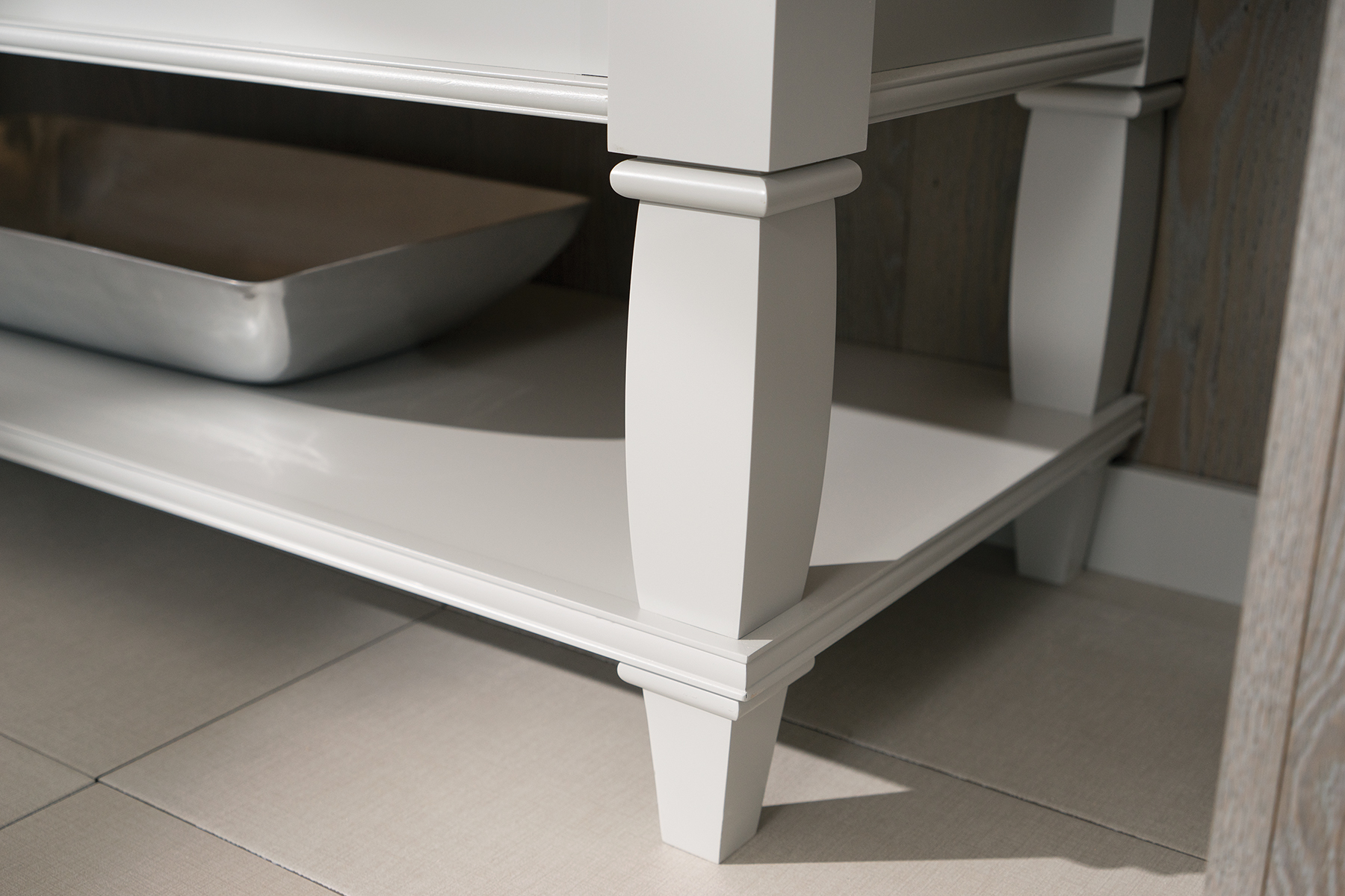 A transitional style turned post on a bathroom furniture vanity by Dura Supreme Cabinetry.