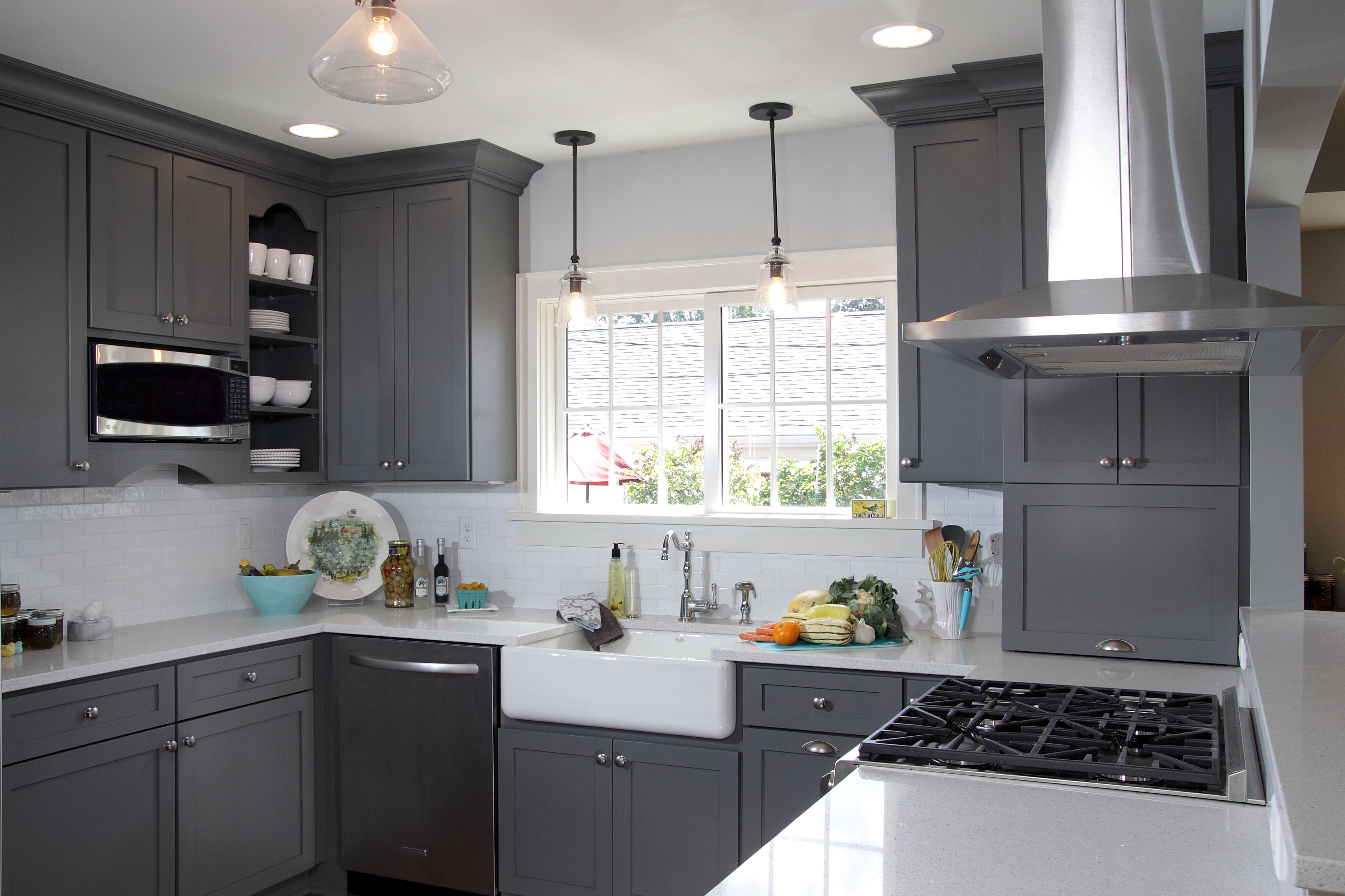 A dark gray and white kitchen with storm gray painted kitchne cabinets from Dura Supreme Cabinetry.