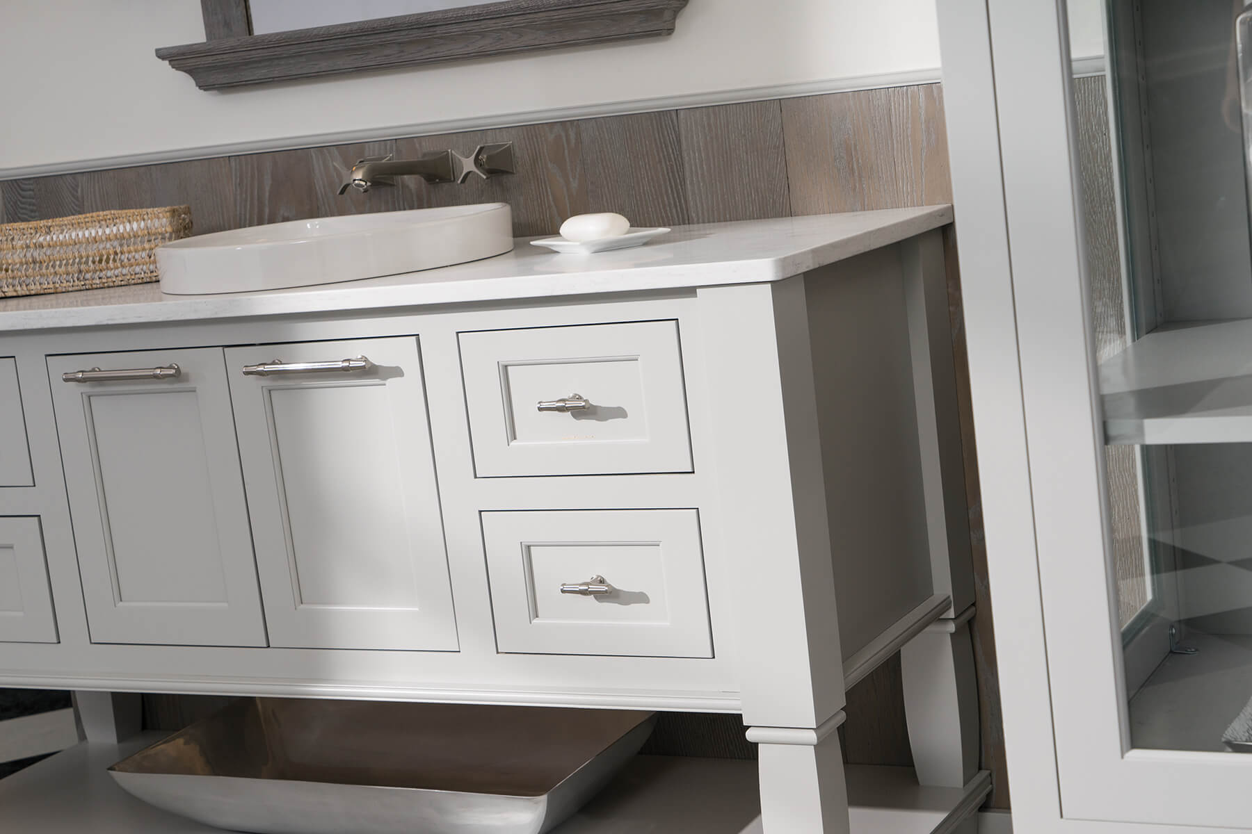 Light gray painted bathroom vanity cabinets from Dura Supreme Cabinetry.