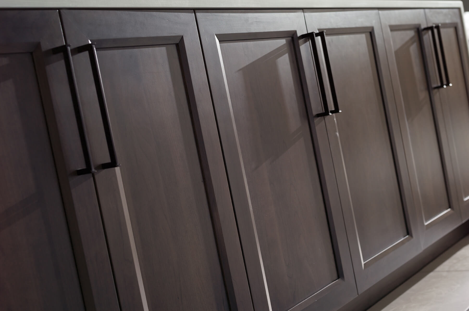 Dark gray stained kitchen cabinets from Dura Supreme Cabinetry.
