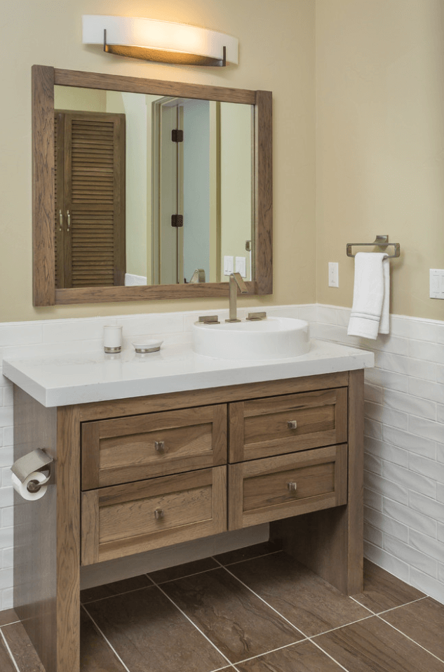 A bathroom featuring one of Dura Supreme Cabinetry's wood furniture vanities designed by Hollie M. Ruocco, CMKBD, Owner of Creative Kitchen Designs, Inc. This photo shows an example of a wood furniture vanity from Dura Supreme Cabinetry.