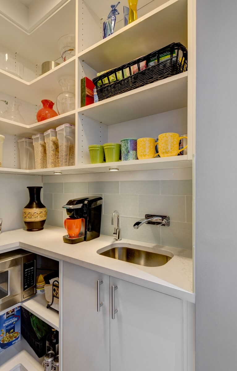 View inside pantry with microwave, sink and storage. Photography by Dennis Jourdan.