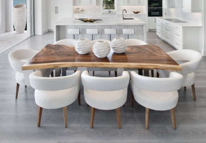 Live edge walnut dining table in contemporary kitchen. Interior design by Natasha Pereira Interior Design in Naples, FL and Design Studio by Raymond. Image by Giovanni Photography.