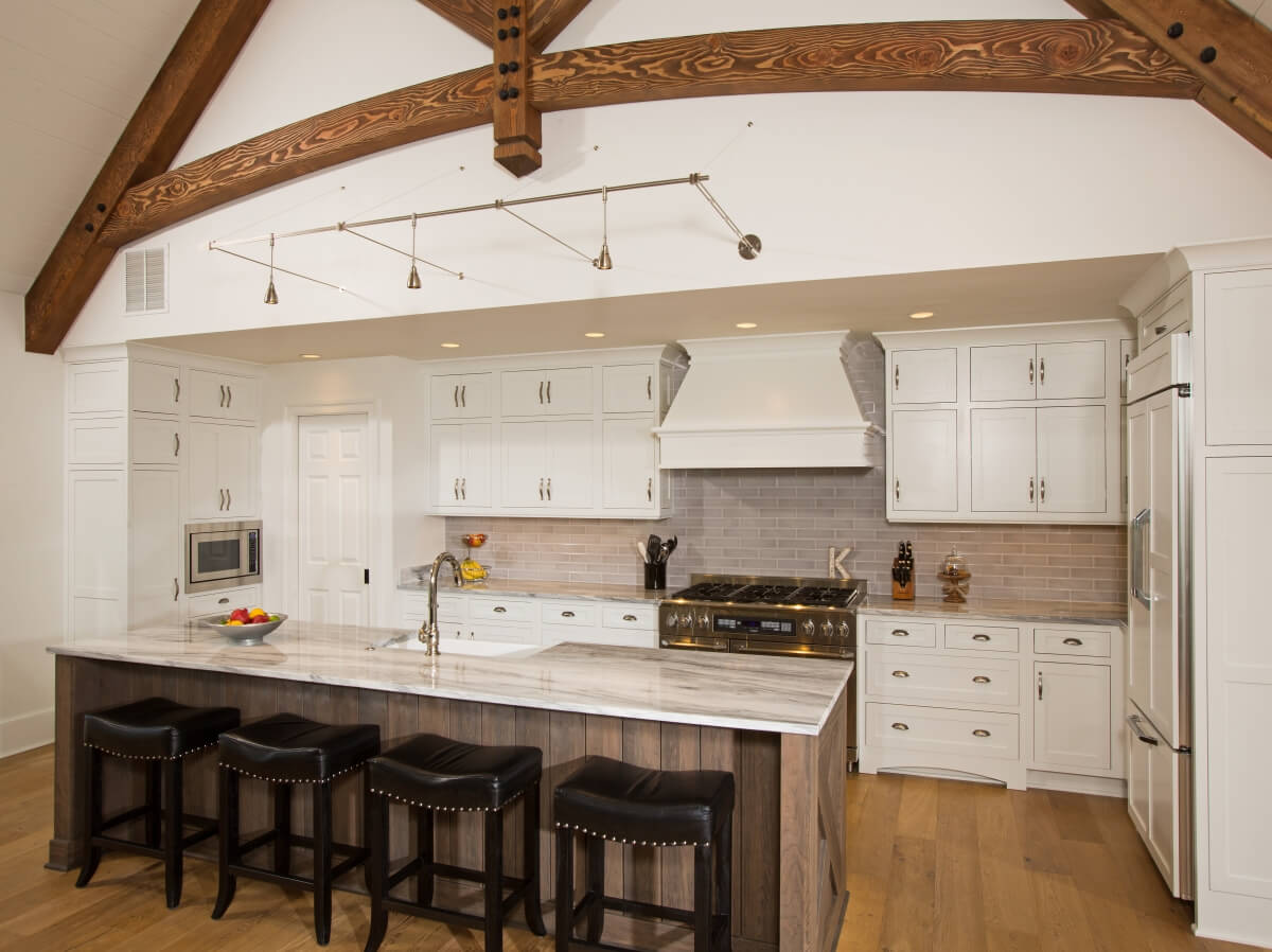 Light and dark cabinetry warmed with wood floors. Homestead Panel Inset Door Style in White Paint and Cherry Weathered D