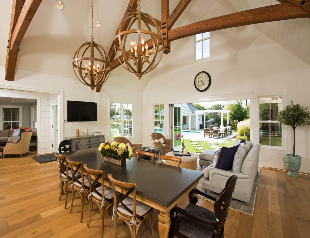 The farmhouse table, with mixed seating and the X motif on the chairs