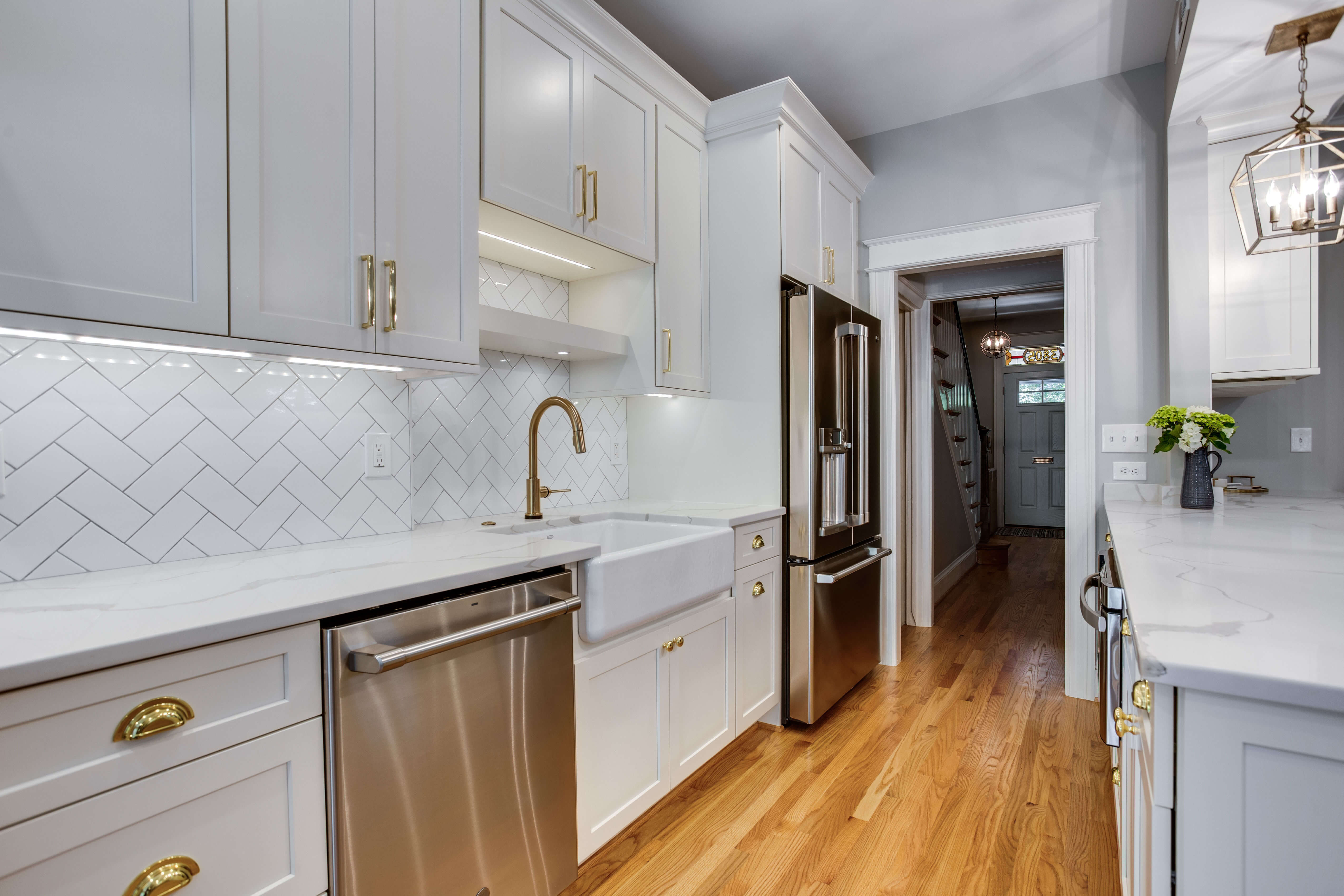 Photo of the beautiful backsplash design that Marissa Shipe suggested for the homeowners kitchen remodel. The design features classic subway tile in a herringbone pattern.