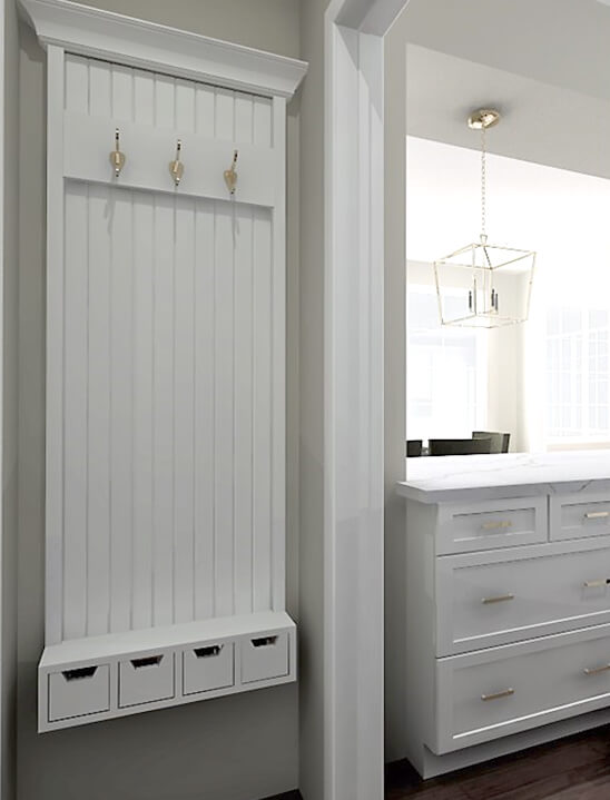 While a custom coat rack right outside the kitchen entry for coats creates great storage for coats, jackets and house and car keys.