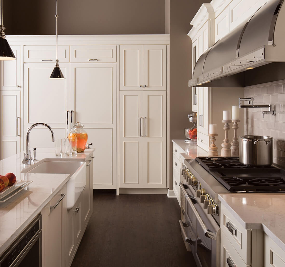 A Storage Wall with Pantries and Refrigeration featuring white painted Dura Supreme Cabinetry.