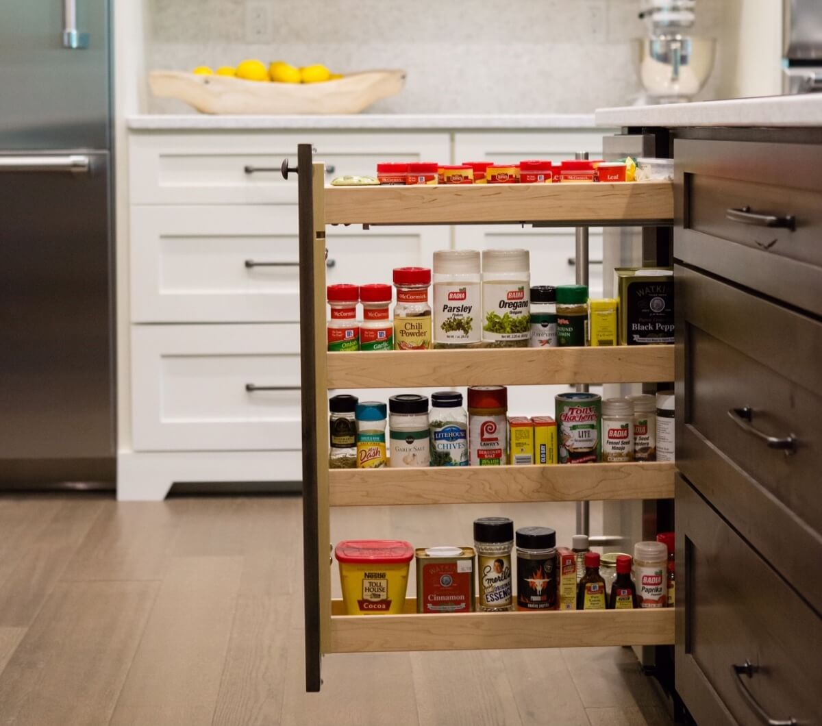 Kitchen Design by Megan Courtney of Cabinet Style, LLC featuring a Base Pull-Out Cabinet with Spice Rack shelves by Dura Supreme.