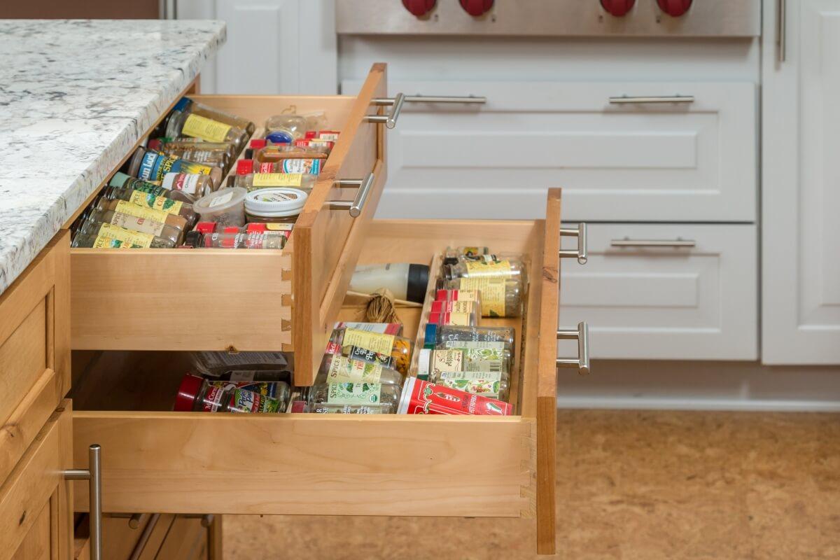 Design by Danielle Bohn, CKBD of Creative Kitchen Designs, Inc. featuring Dura Supreme Cabinetry Spice Rack Drawer.