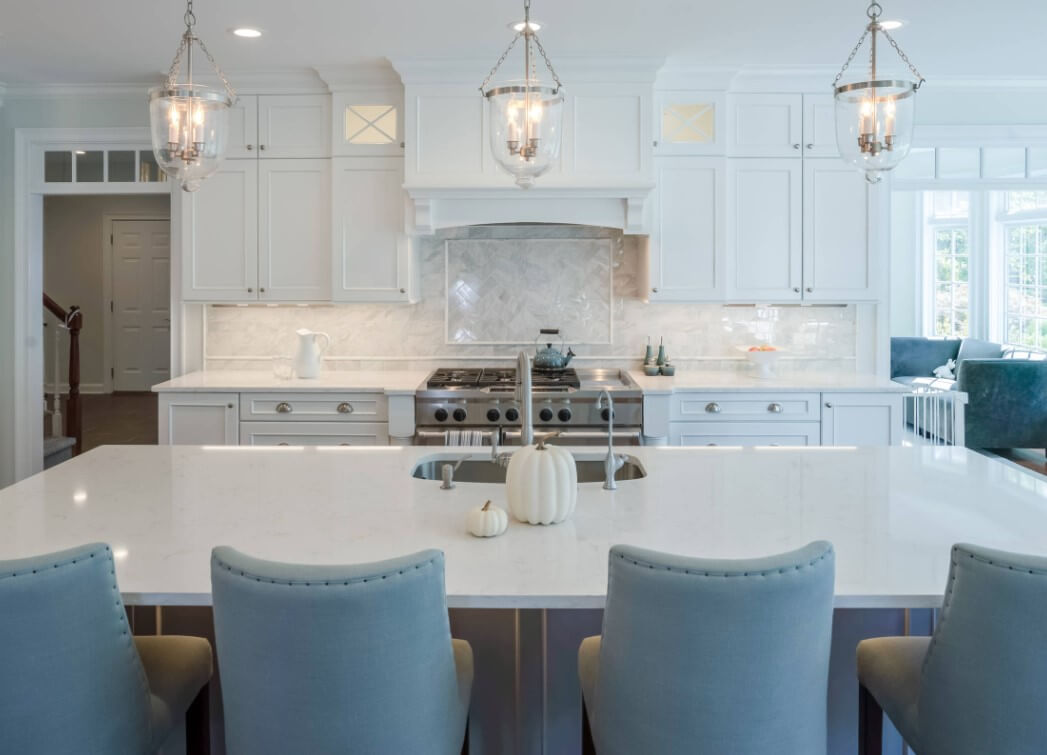 Blue Bar Stools in a Dura Supreme Cabinetry kitchen. Kitchen design by Lang's Kitchen & Bath, photography by Linda McManus.