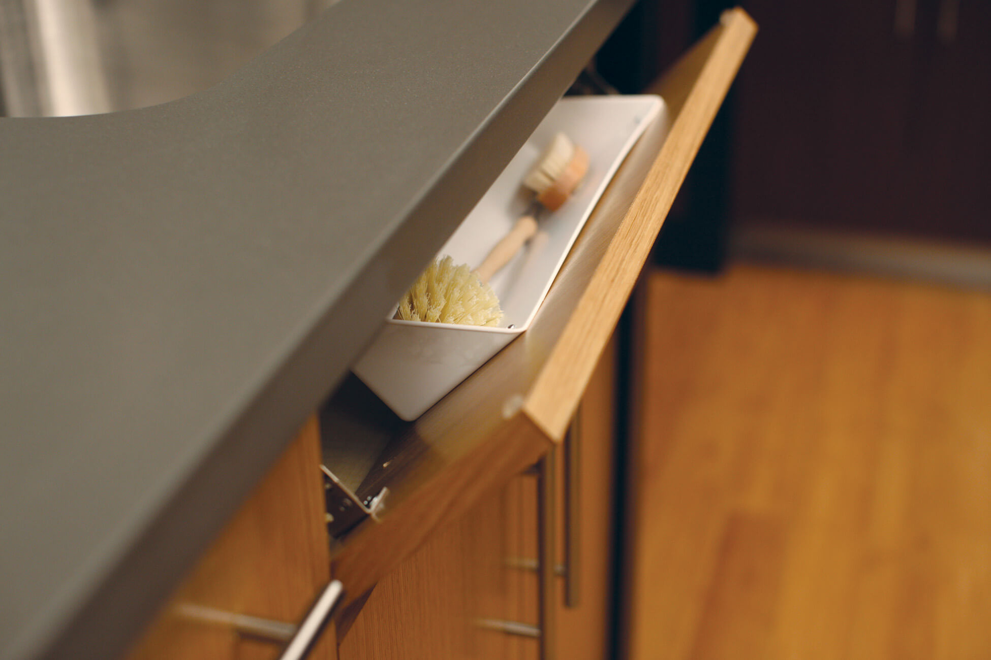 Neatly conceal all your scrub brushes and dish scrapers when they are not in use with this tip-down sink tray (TDFS) from Dura Supreme Cabinetry.