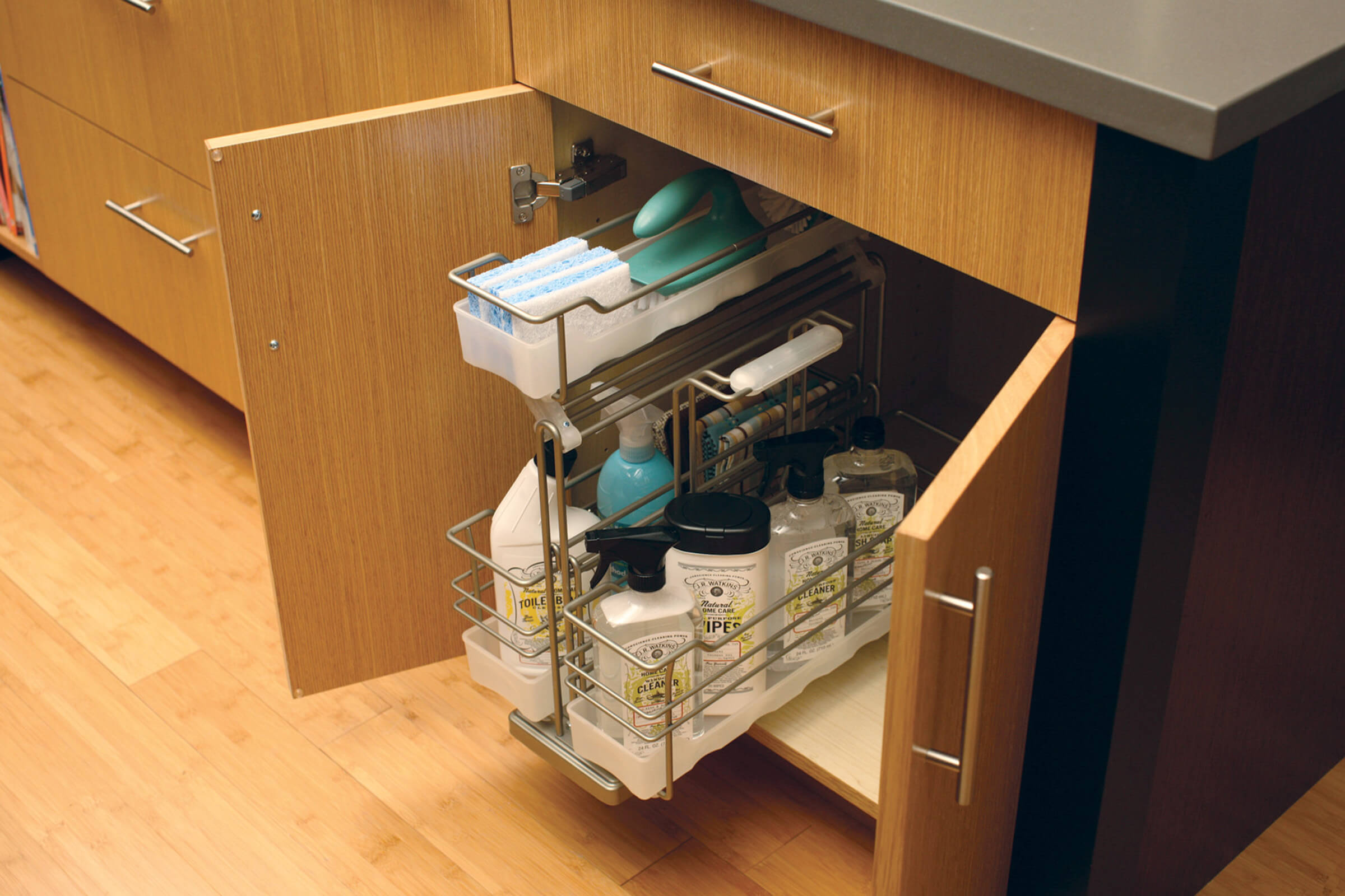 Organize cleaning supplies in our convenient pull-out caddy with detachable, portable basket (SBPOC) from Dura Supreme Cabinetry.