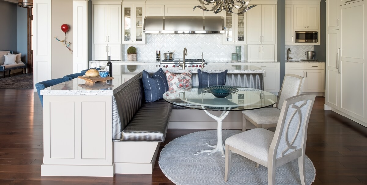 An L-Shaped Kitchen Island with a Breakfast Nook. Dura Supreme Cabinetry design by Michels Homes. Photo by Landmark Photography.