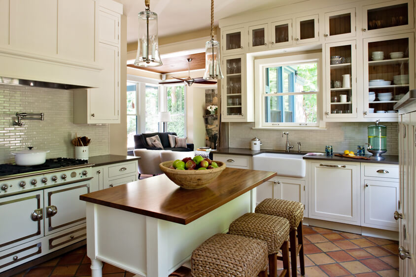 A furniture styled kitchen island with counter height seating. Dura Supreme Cabinetry design by Sandra Brannock & Cynthia Alsaif of NVS Kitchen & Bath Inc., Virginia.
