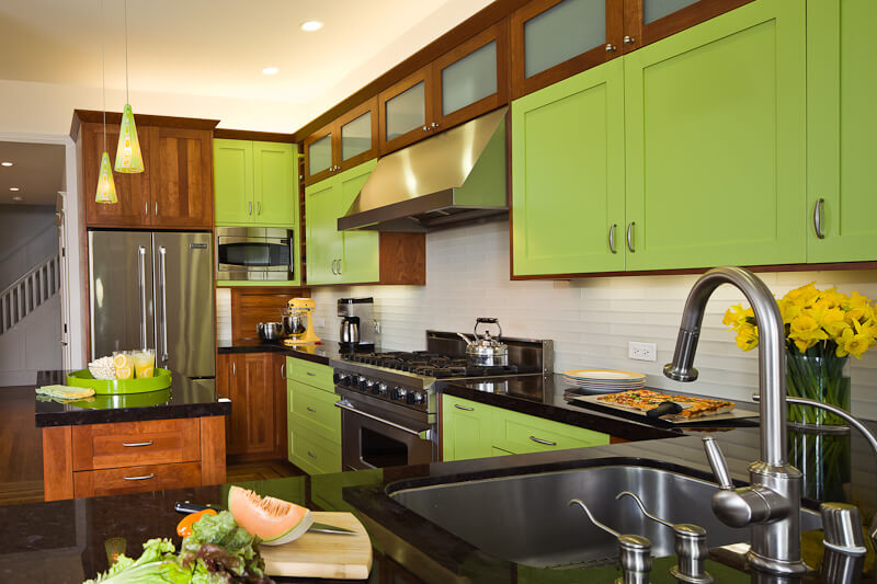 Dura Supreme cherry cabinetry with accent doors of custom green paint. Design by Barbra Bright of Barbra Bright Design, California.
