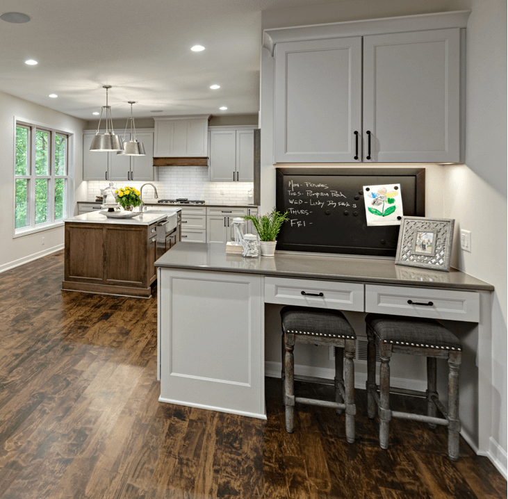 A charming Kitchen Command Center sits adjacent from a beautiful kitchen designed by Kristen Peck of Knight Construction Design. Photographed by Mark Ehlen of Ehlen Creative.
