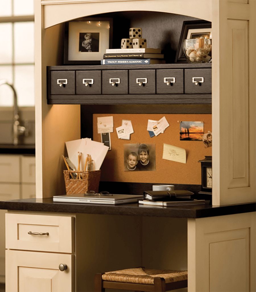 An office desk in a kitchen. Kitchen cabinets and office desk by Dura Supreme Cabinetry.