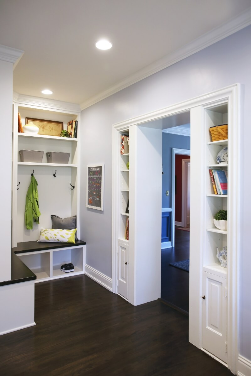 The doorway into the dining room was framed with built-in cabinetry and shelving to add a space for the homeowners to display decor while providing additional storage.
