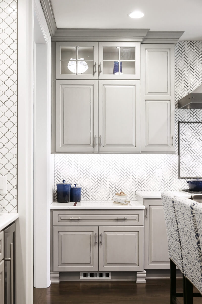 The baking center space has a lower countertop to make food prep easier for the homeowner.