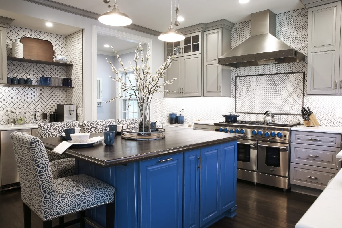 The unique blue color of the kitchen island was selected with the inspiration of the family's treasured dishware from the Czech Republic.