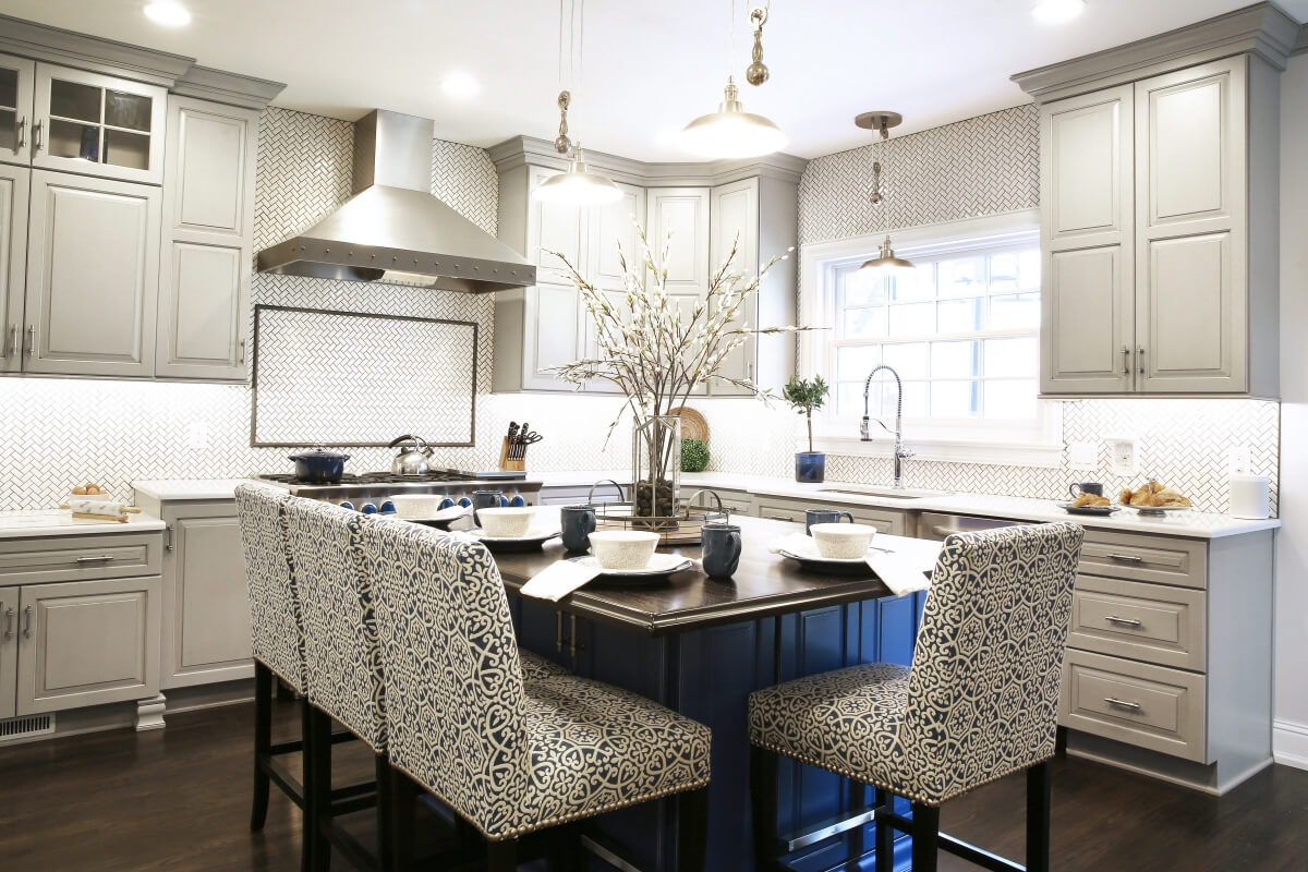 A beautiful blue kitchen island was added to include seating for all 4 family members.