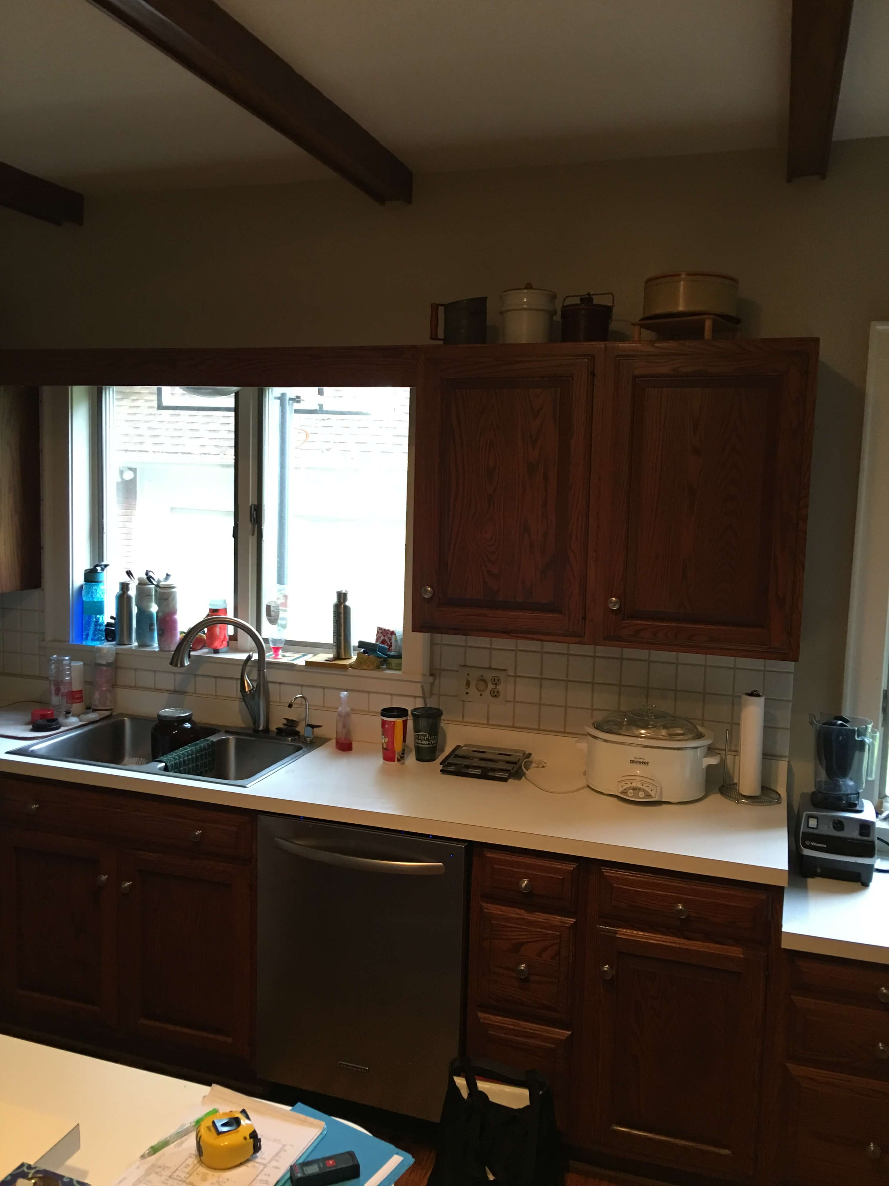 Before remodel photo of a dark outdated kitchen in a historic home.