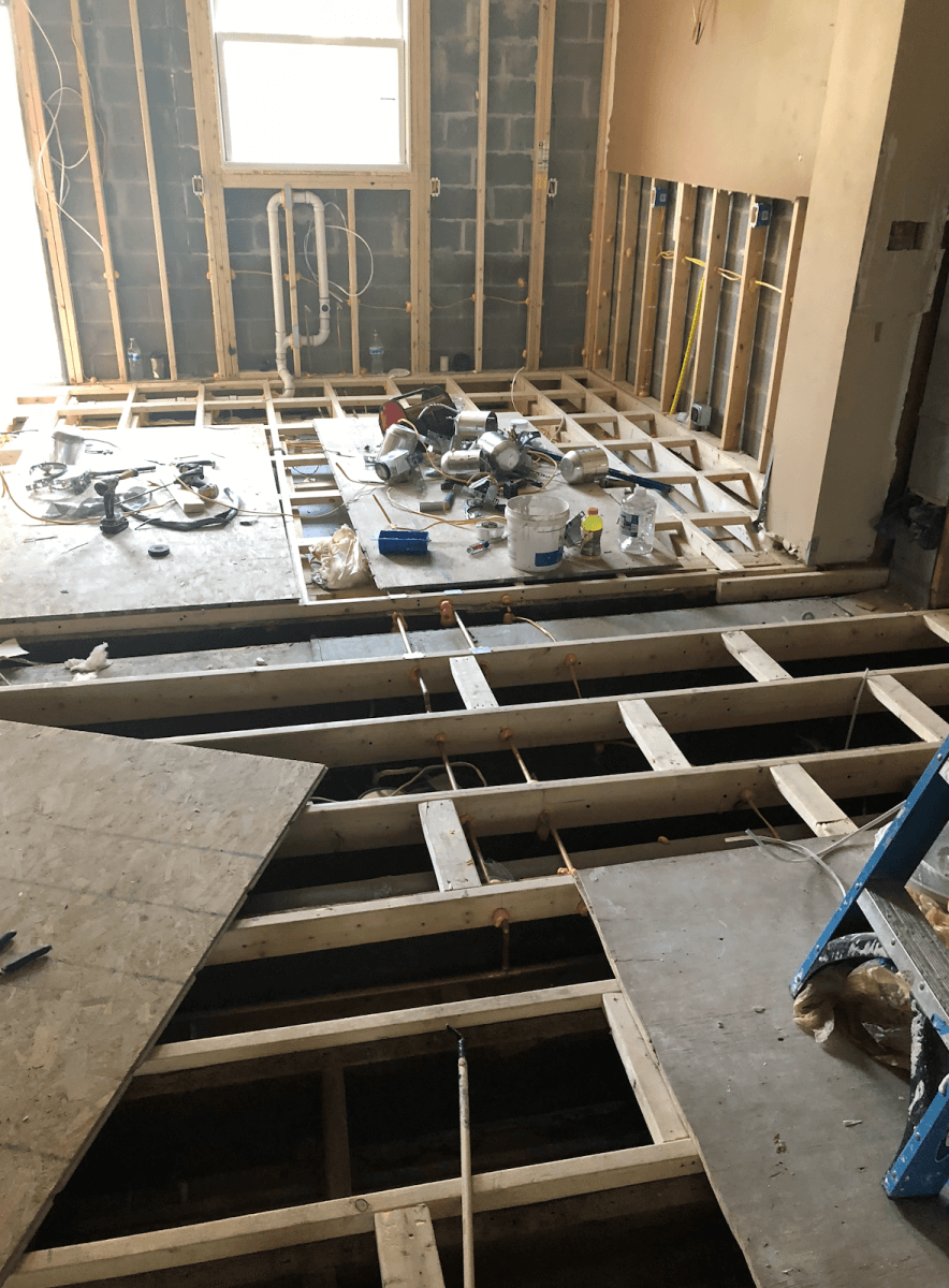 To solve the issue of the floor slope, contractors sistered the floor joists along the entire first floor to set a solid foundation for the new flooring and cabinetry.