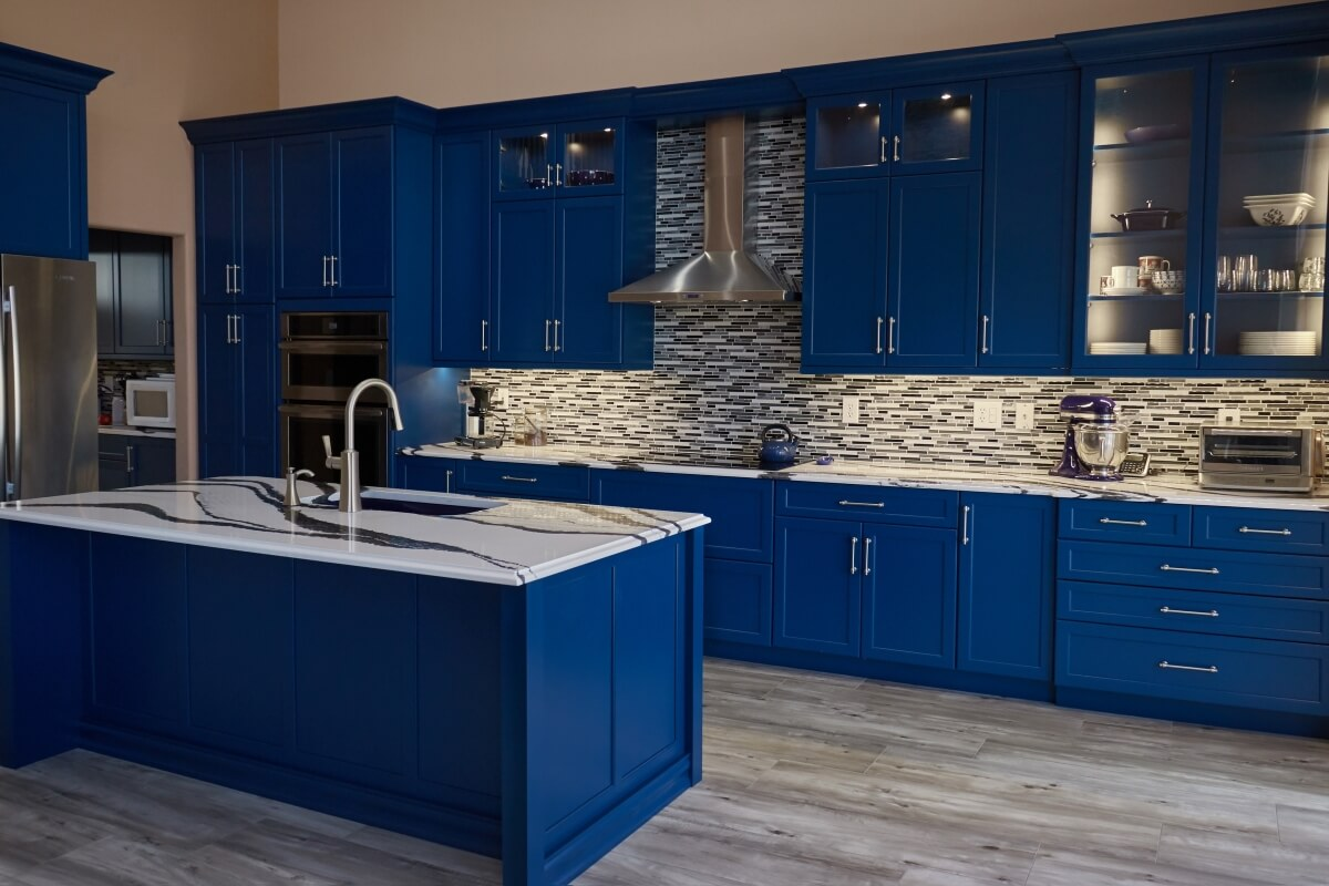 Beautiful, bold blue kitchen designed by the Design Team at Artistic Cabinetry.
