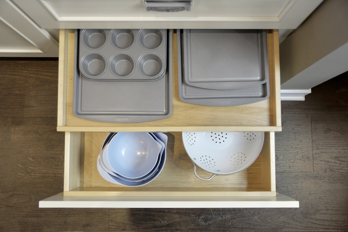 Roll-outs can be incorporated inside a drawer to create an added level of organization.