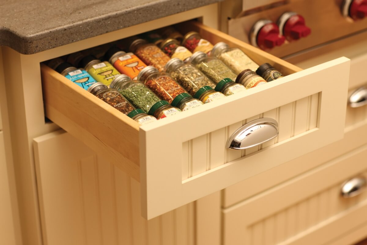 Keep your spices at your fingertips in this convenient, wood Drawer Spice Rack next to an oven or baking center. Kitchen Storage solutions for spice racks from Dura Supreme Cabinetry.
