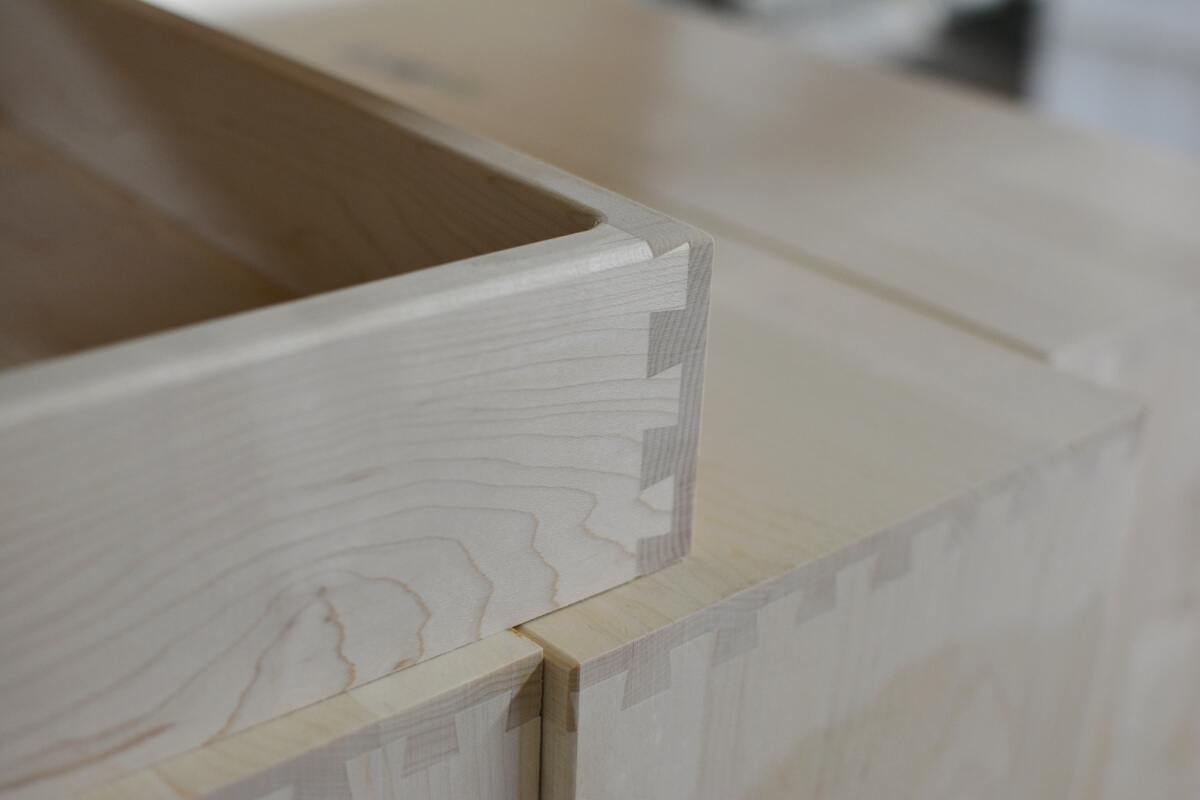 A dovetail drawer box from Dura Supreme Cabinetry shown during construction on the factory floor.