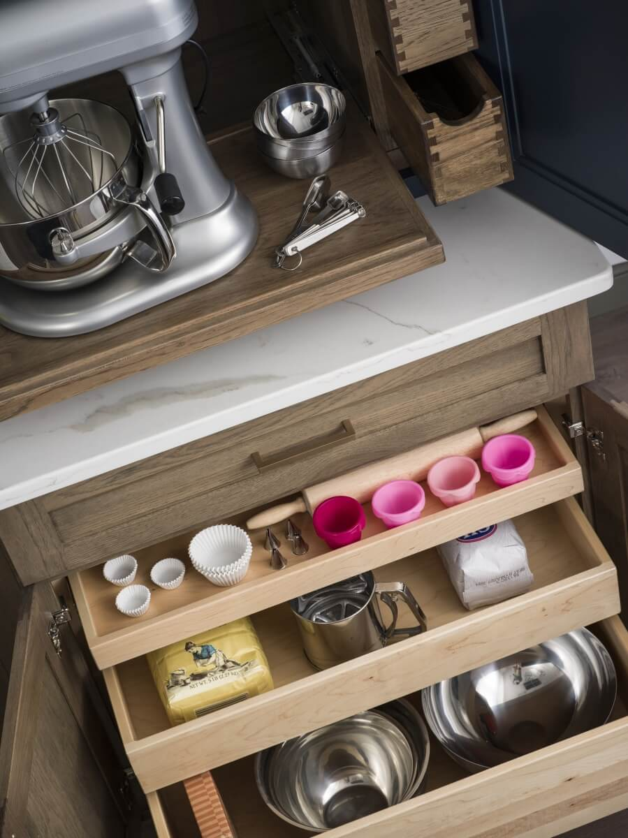 Roll-out shelves in a base cabinet for easy accessible storage. Kitchen cabient storage solutions from DUra Supreme Cabinetry.