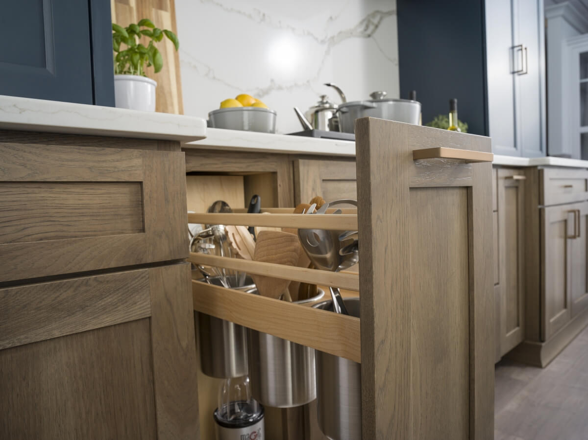 A Kitchen Utensil Pull-Out cabinet provides and easy to access space to organize your larger kitchen utensils.