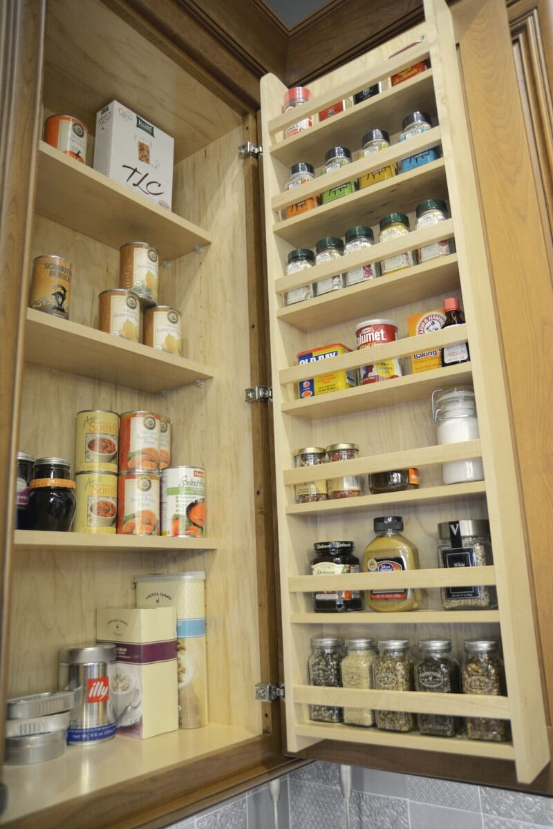 A traditional Door Spice Rack from Dura Supreme offers convenient kitchen storage in a wall cabinet. Kitchen cabinet storage from Dura Supreme Cabinetry.