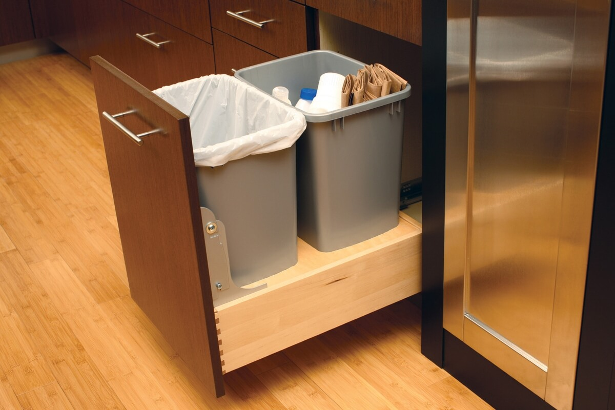 A m-out cabinet with two trash bins for waste and recylcing. Kitchen Cabinets and Storage from Dura Supreme Cabiinetry.