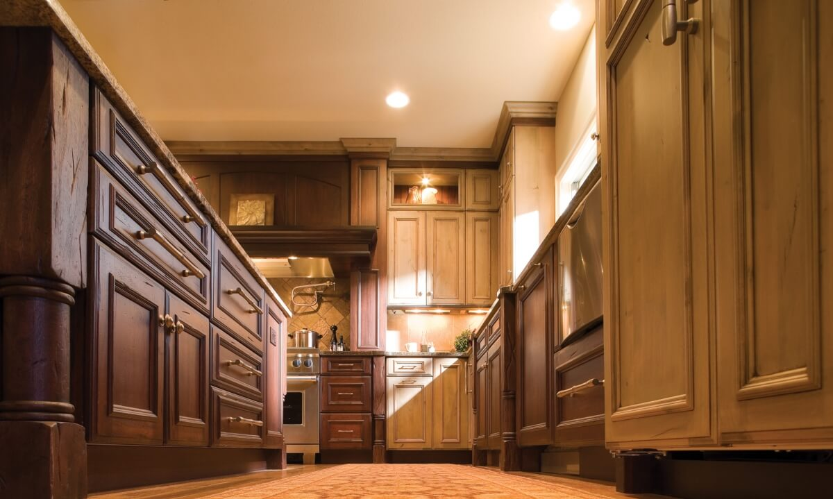 A mixture of two different kitchen cabinet woods and finishes in a mountain resort styled kitchen design.