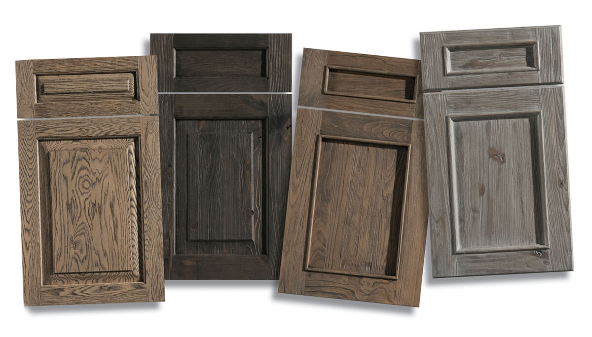 A collection of Weathered wood cabinet doors with a beautiful distressed wood finish from Dura Supreme Cabinetry.