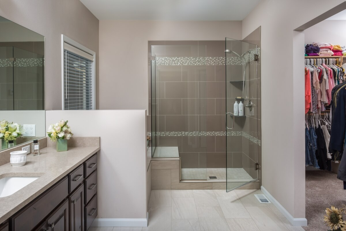 his charming master bathroom provides plenty of clear space for its primary users to function and move around safely. Designed by Danielle Bohn, CKBD at Creative Kitchen Designs, Inc., Alaska.