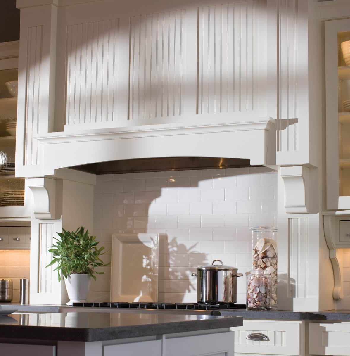 Dura Supreme Cabinetry wood hood with a beadboard look.