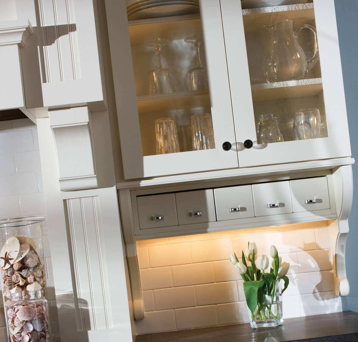 Glass cabinet doors in a cottage style kitchen design with Dura Supreme Cabinetry.