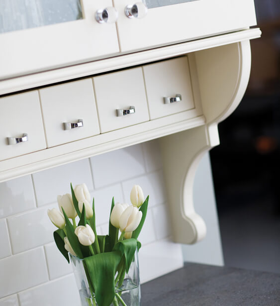 Add a vertical or horizontal row of apothecary drawers to add storage for your misc. items with some cottage flare.