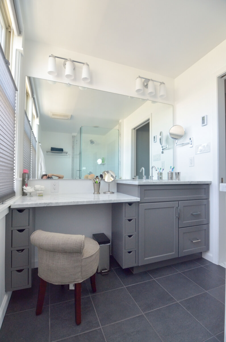 This bathroom space features a prime example of incorporating varied height vanities for the primary user. The lower portion is ideal for putting on make-up while the taller vanity is great for washing your hands and face. Bathroom was designed by Devin Mearing of dRemodeling, Philadelphia PA.