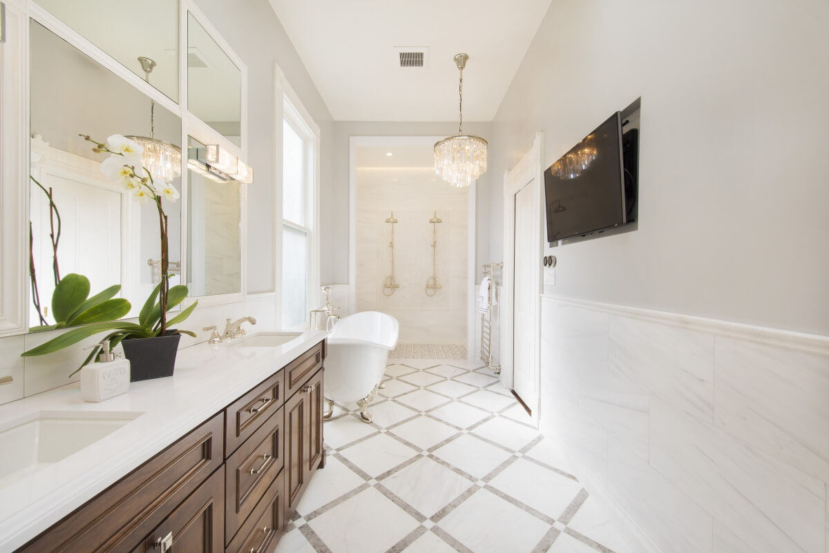 This exquisite bathroom designed by Gilmans Kitchens and Baths in California is a perfect example of having enough clear space in front of all the bathroom fixtures.