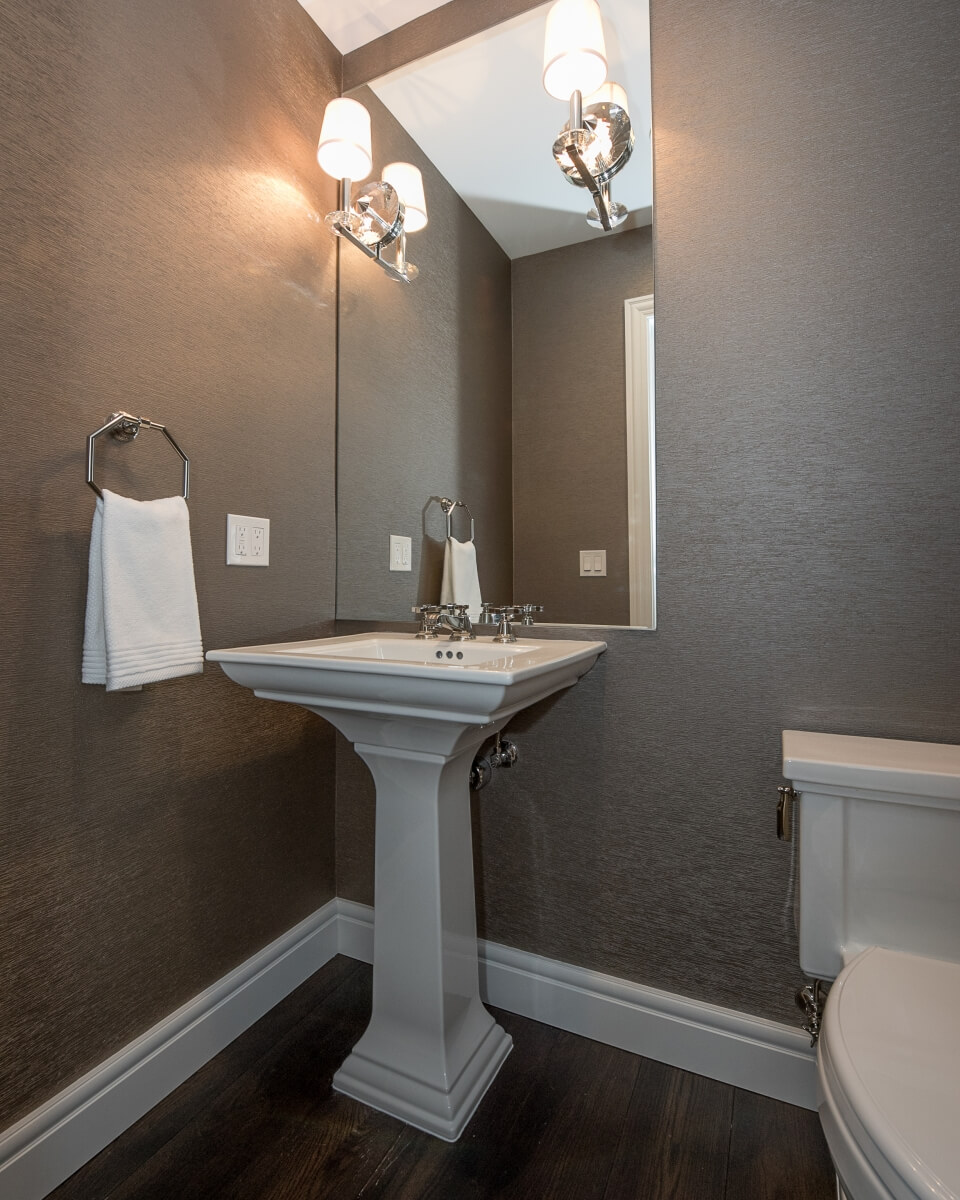 Example of the NKBA Bathroom Guideline Single Lavatory Placement for a free-standing pedestal sink. Designed by Pinnacle Design, Saginaw, Michigan, and photographed by Dan Denardo.