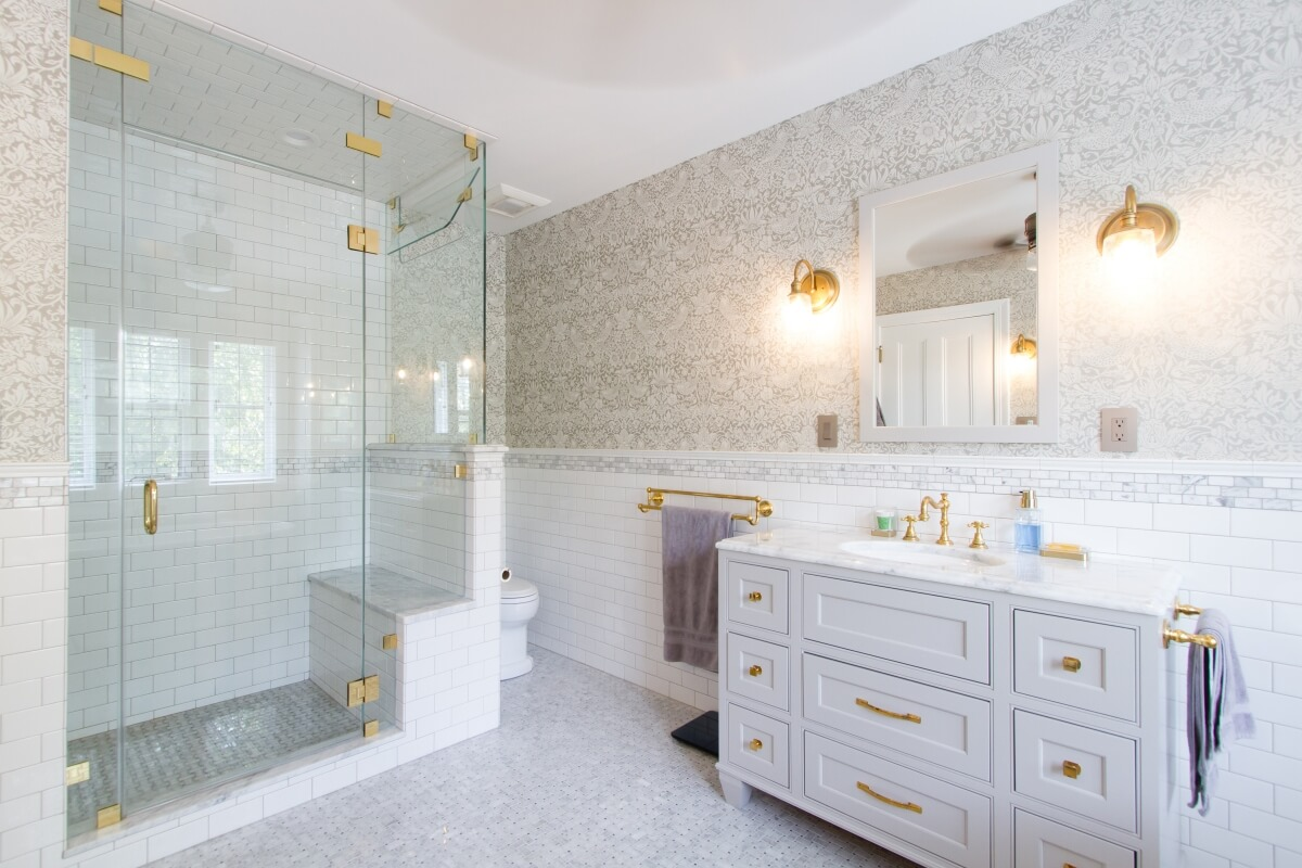 The shower in this lovely bathroom is a perfect example of a decent shower size that provides an incorporated bench and plenty of elbow room to bath and move around properly. Bathroom designed by Theresa Major of North Shore Kitchen and Bath, Milwaukee, WI.