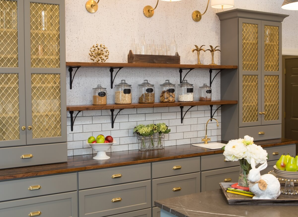 Gold accents set the stage for this dazzling Dura Supreme hutch designed by Michelle A. Lecinski of Advance Design Studio, Ltd., Gilberts, IL
