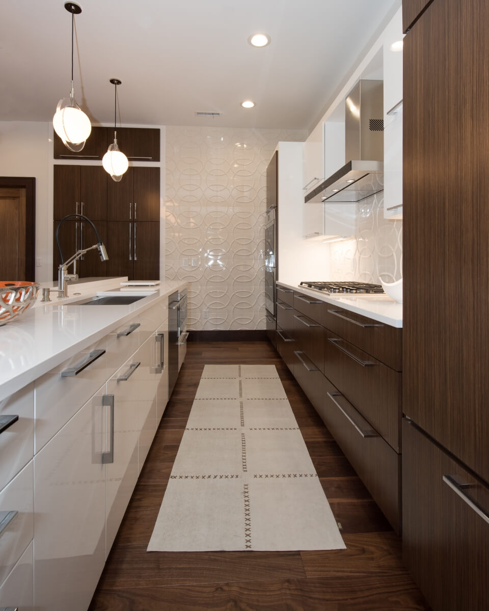Galley Kitchen Design with a modern style and slab cabinet doors from Dura Supreme Cabinetry.
