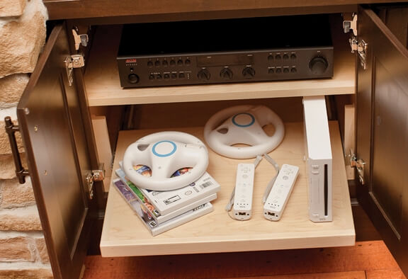 A Flat Roll-Out Shelf is an ideal system for gaming equipment.
