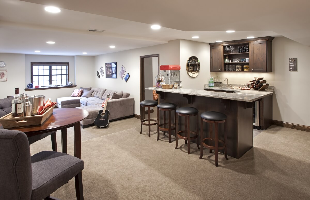 The remodeled finished basement featuring a Dura Supreme Cabinetry wet bar.